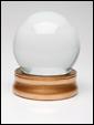 Стекляный шар, размещеный на красивой подставке, с надписью: сегодня вас ждет сюрприз.